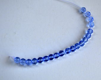 light blue glass faceted round 4mm