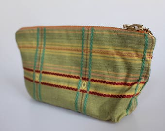 """Green-yellow-red checkered cosmetic bag with charm bracelet-City crest pendant """"Soltau"""" and Messingfarbenem zipper"""