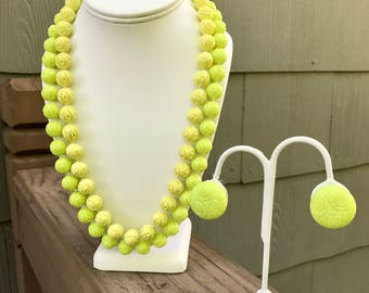 Carved chartreuse floral design beaded necklace and earrings, circa 1960s-70s, chunky plastic
