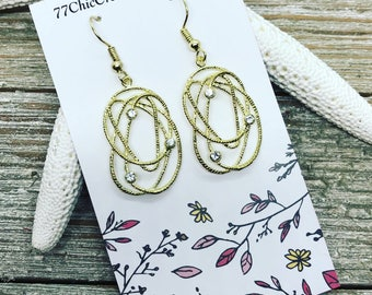 Delicate and light weight gold tone earrings.
