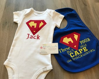 These fools put my cape on backwards, superman inspired onesie, canada, superhero, personalized baby bib, velcro bib, cute saying.