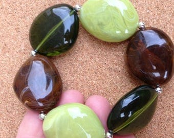Bracelet -  in sage green and lime green and brown marbled and transparent plastic pebble shaped bead bracelet retro design