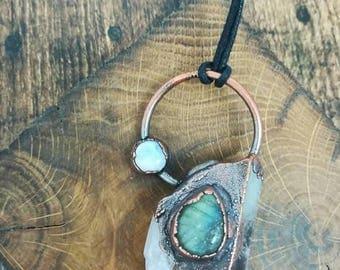 Raw clear quartz crystal, moonstone and labradorite copper electroformed pendant on adjustable black cord