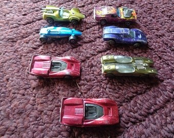 7 Original Mattel 1968-72 redline hot wheels cars in various shapes