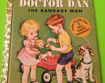 1977 DOCTOR DAN The Bandage Man  Little Golden Book  with Real Plastic Bandages