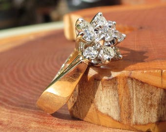 A vintage 14k yellow gold 0.45 Carat diamond cluster ring.