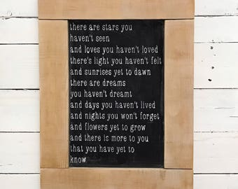 There are stars faux chalkboard wood sign