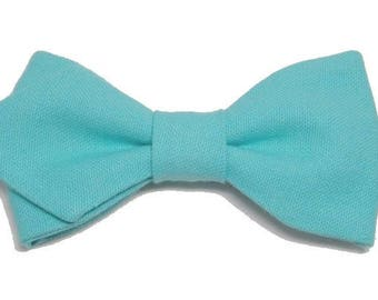Turquoise bowtie with sharp edges