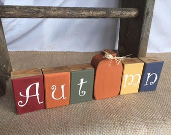 Handmade autumn wooden blocks with pumpkin