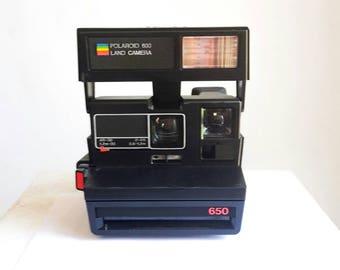 Polaroid camera black 650. Running