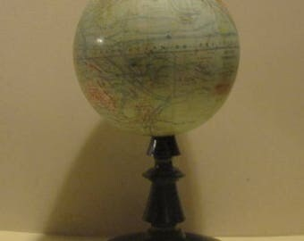 a very small antique globe by Forest, Paris 1920
