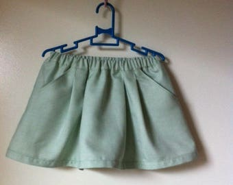 pretty skirt pleats and green pockets of water for 3-4 years old