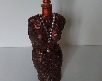 Bottle covered with mosaic tesserae bust