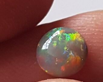 0.6ct Round 7mm Multicoloured Lightning Ridge Black Opal