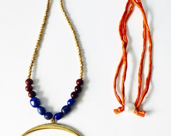Statement necklace with crescent focal---rosewood and lapis detail with handyed silk cord and freshwater pearl closure