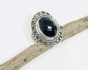 Fasceted Black Onyx ring set in sterling silver 925. Size - 6. Natural authentic fascted black onyx stone. Satisfaction guaranteed .