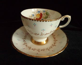 TUSCAN Fine English Bone China Teacup and Saucer Set with Gold Gilding and Baby Blue Raised Dots Design and Floral Design Scalloped England