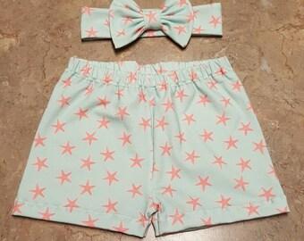Aqua with Coral Starfish  Print Jersey Knit Shorts with Matching Bow Headband. Baby Girl Shorts Set
