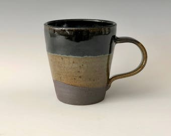 Modern large 12 oz handmade pottery coffee/tea cup earth tones with black and blue highlights Haight Pottery Company