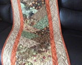 Extra long harvest quilted table runner in taupe browns with orange accents, thanksgiving table topper, reversible quilted table runner,