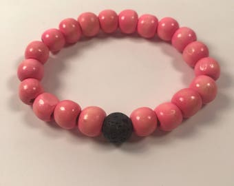 Pink wood bead and lava stone bracelet