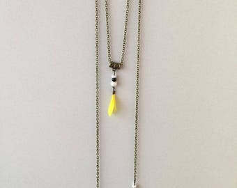 Long double yellow/white/black color with yellow feather