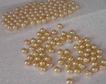 ROUND 6MM LIGHT CREAM GOLD GLASS BEADS