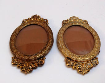 Two small vintage brass picture frames