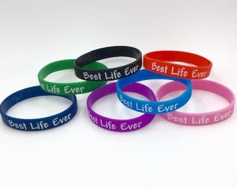 """Lot of 10 - """"Best Life Ever"""" Silicone Wristbands in Blue, Navy, Black, Red, Green, Pink, or Purple. Great gift idea!"""