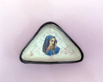 Ceramic ringdish with a geometric pattern and a Holy Mary Decal