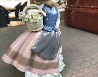 Vintage Lladro Sweet Scent figurine 5221 girl with flower basket and bonnet. Made in Spain, 1980's
