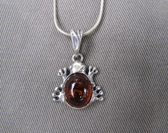 Sterling silver and amber frog pendant