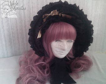 Velvet Lolita fashion bonnet with golden ribbons and black peony