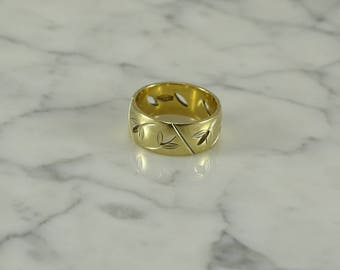 14K Gold Band Open Leaf Design (size 7)