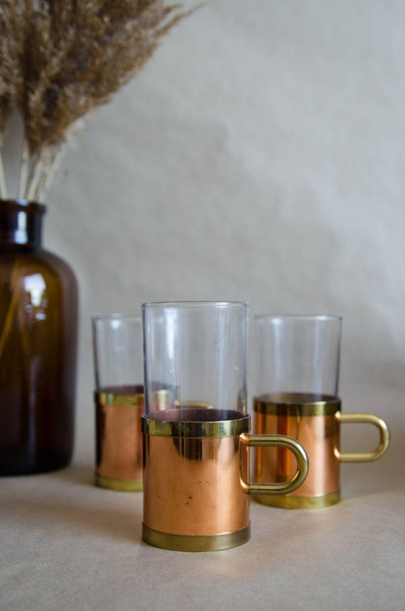 Set of 3 glass cups with solid brass and copper handlers