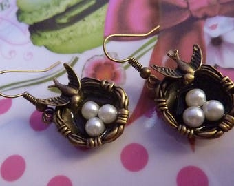 Earrings in antique bronze bird swallow and nest pearls White Pearl
