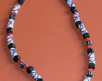 Camino jewelry necklace, with multicolored African beads and Scallop Shell