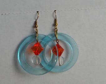 Blue hoop with orange and clear dangling center