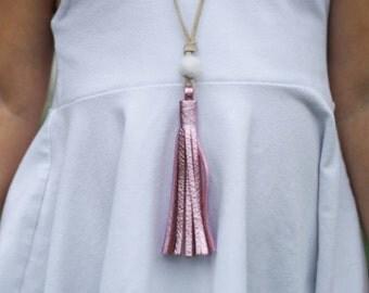 Girls pink metallic tassel necklace with small wool felt pom pom