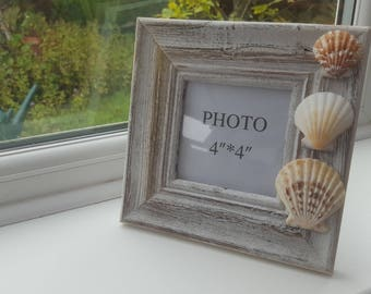 Rustic wooden photo frame with clam shells