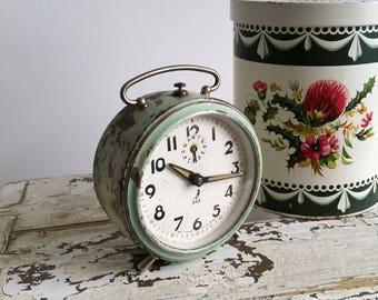 Old alarm clock 'Jaz' green