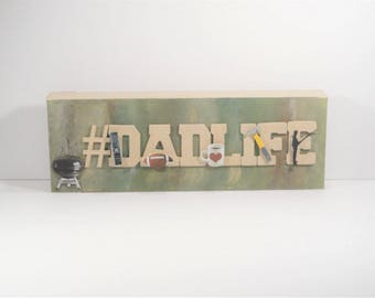 """Our #DADLIFE design is a fun and unique gift for dad!  We can customize to your dad's favorate """"likes"""", just ask us!"""