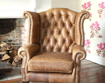 queen anne high back wing chair in vintage tan leather