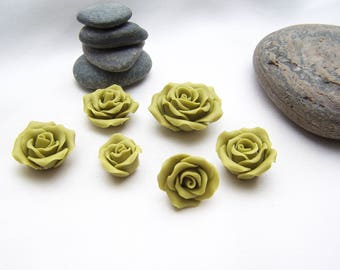 6 green cold porcelain flowers