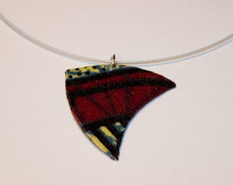 Pendant in Burgundy and black African fabric