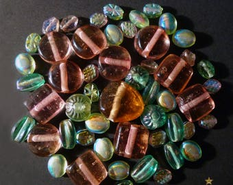 52 Indian pink, green of various shapes glass beads