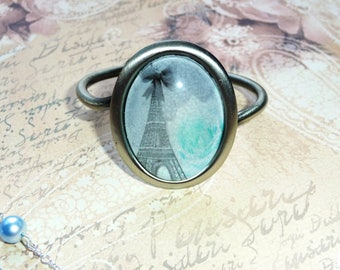 Bracelet stiff blue vintage Paris Eiffel Tower with bow and turquoise rose, adjustable antique silver ring setting, glass 4x3cm cabochon