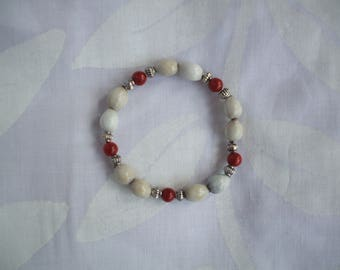 Bracelet made of bamboo coral beads, metal tops and job's tears