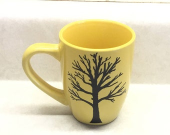 Yellow ceramic mug, acrylic black paint, sealed and baked