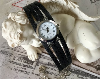 Wristwatch woman size UNIQUE round silver black